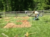 Using a broadfork to break up compacted clay soil