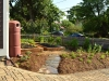 Rain barrel and native pollinator landscape